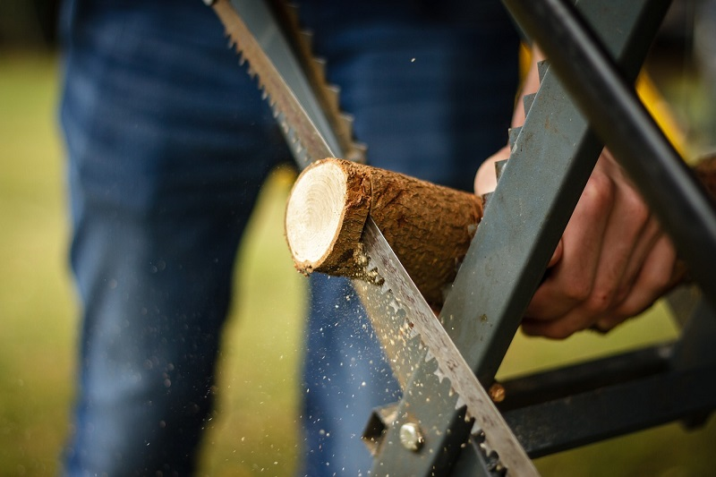 A man sawing wood