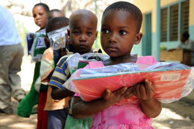 Little children holding books